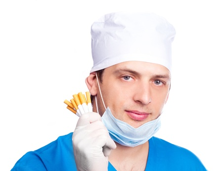 portrait of doctor wearing a mask and blue uniform and holding cigarettes, isolated on white background photo