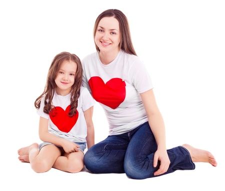 six girls: happy mother and her six year old daughter wearing T-shirts with big red hearts, isolated against white background