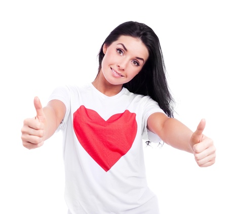 big woman: happy young  woman wearing a T-shirt with a big red heart with two thumbs up, isolated against white background Stock Photo