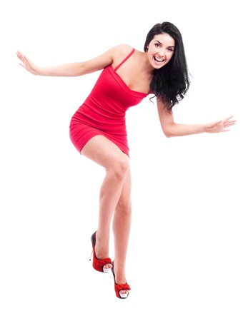 girl in red dress: beautiful happy brunette woman, isolated against white background Stock Photo