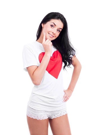 beautiful young woman wearing a T-shirt with a big red heart, isolated against white background Stock Photo - 12018875