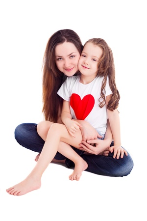 6 year old children: happy mother and her six year old daughter wearing T-shirt with big red heart, isolated against white background