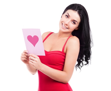 beautiful young  woman holding a Valentine photo