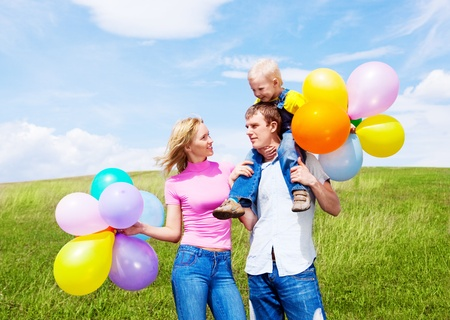 happy family with balloons outdoor on a warm summer day Stock Photo - 12070748