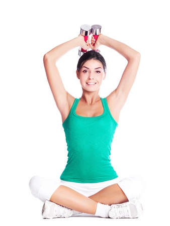 underarms: beautiful young  woman working out with dumbbells, isolated against white background