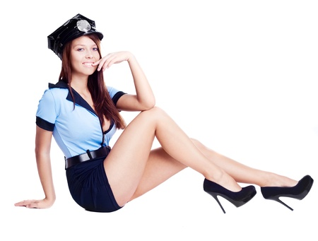 young sexy policewoman,  isolated against white background photo