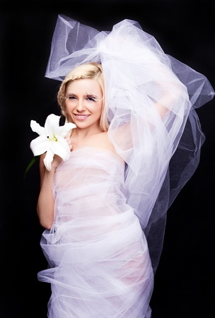 tulle: beautiful young blond bride with a lily and creative makeup