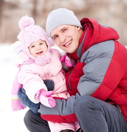 happy young father with his daughter spending time outdoor in the winter park Stock Photo - 12063668