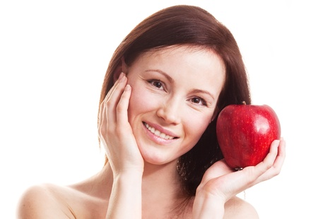 40 years old: beautiful adult woman with an apple isolated against white background Stock Photo