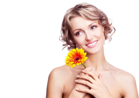 beautiful young blond curly woman with a flower in her hands, isolated against white background photo