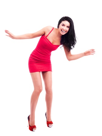 mini dress: excited happy brunette woman, isolated against white background