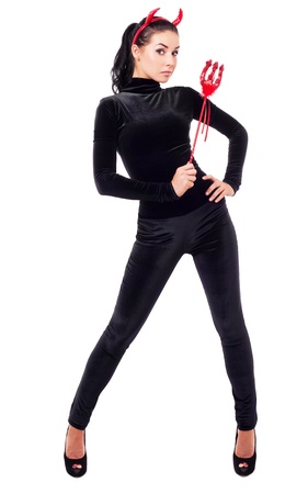 devil horns: sexy brunette girl wearing a costume of an imp, isolated on white background