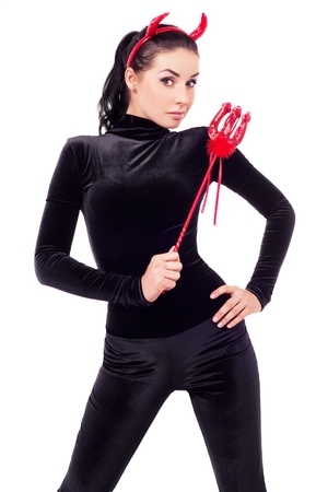 sexy brunette girl wearing a  costume of an imp, isolated on white background photo