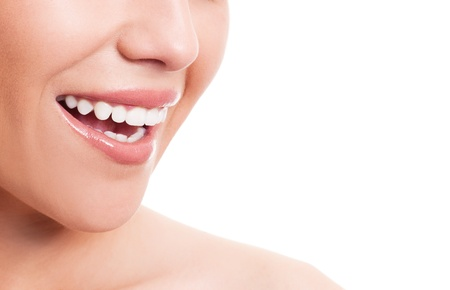 year profile: closeup of the face of a young woman with healthy white teeth, isolated against white background