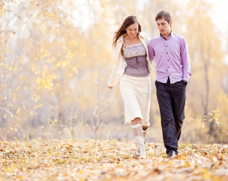 low contrast portrait of a happy loving couple walking  outdoor in the autumn park  photo