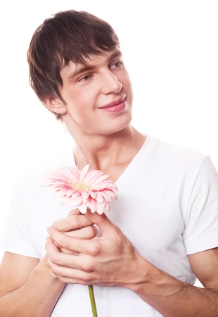 the seducer: handsome young man with a pink flower, isolated against white background Stock Photo