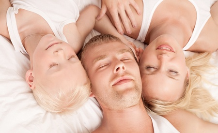 happy family: mother ,father and their son under the blanket  in bed at home (top view) Stock Photo - 12714416