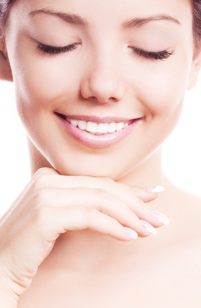 touching face: closeup of the face, hands and healthy white teeth of a woman, isolated on white background