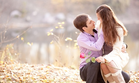 happy young couple  outdoor in the autumn park