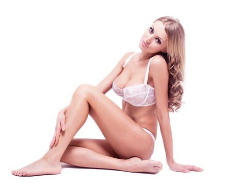 beautiful sexy blond woman wearing underwear, isolated on white  studio background Stock Photo - 12989770