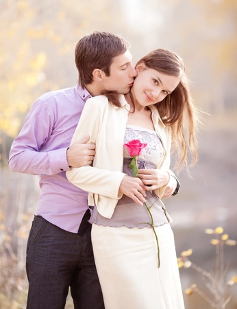 tender passion: low contrast portrait of a happy young couple  outdoor in the autumn park  Stock Photo