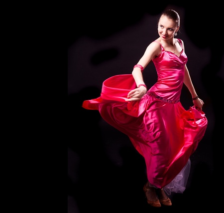 salsa dancing: beautiful dancer woman on a black isolated background, copyspace for your text to the left Stock Photo