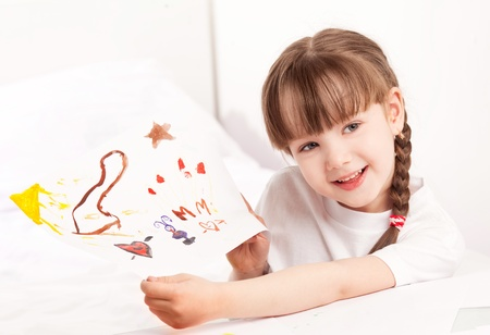 happy cute five year old girl painting with watercolor at home and showing us the picture Stock Photo - 13046607