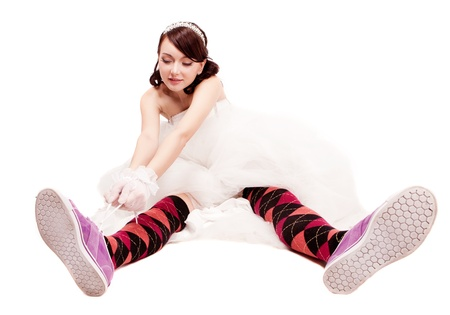 studio portrait of a happy bride wearing sneakers  and stockings photo