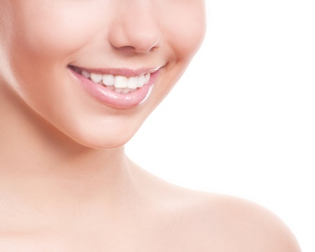 girl teeth: closeup of the healthy white teeth of a woman, isolated against white background, copyspace for your text to the right