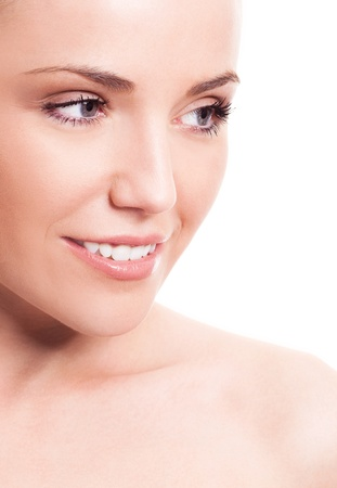 closeup of the face of a young beautiful woman with healthy white teeth, isolated against white background photo