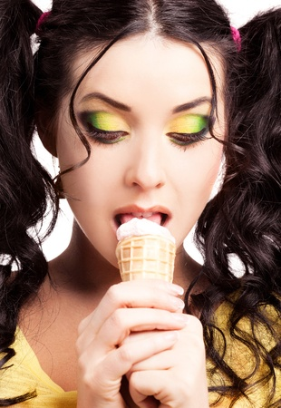 sexy lollipop: pretty  brunette woman eating an ice scream, isolated against white background