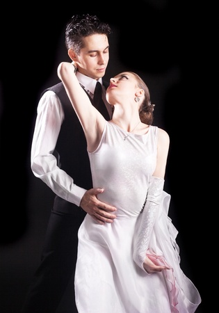 sexy couple embrace: dancing couple, isolated on black background