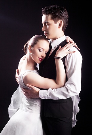 dancing couple, isolated on black background