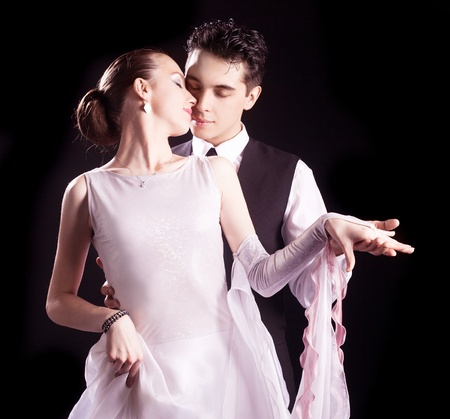 ballroom dancing: dancing couple, isolated on black background