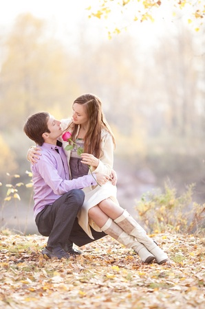 low contrast portrait of a happy young couple  outdoor in the autumn park  Stock Photo - 13331300