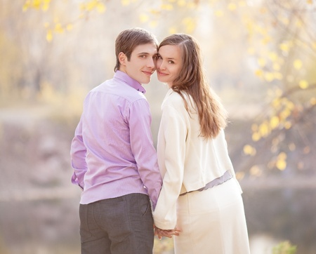 low contrast portrait of a happy young couple  outdoor in the autumn park  Stock Photo