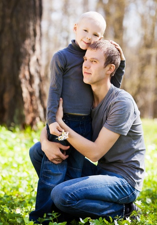 happy  family; youngfather and his six year old son spending time outdoor on a summer day Stock Photo - 13701825