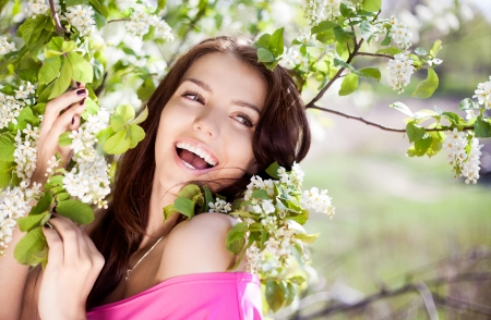 beautiful laughing brunette woman in the park on a warm summer day Stock Photo