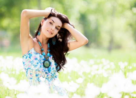 underarms: beautiful young  brunette woman outdoor on a summer day Stock Photo