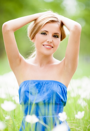 underarms: happy young blond woman outdoor on a summer day