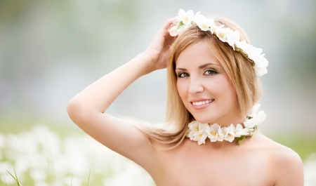 underarms: young blond woman wearing a crown of flowers outdoor on a summer day Stock Photo