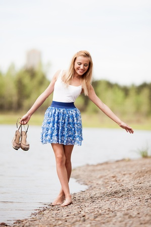 happy young blond woman outdoor on a summer day photo