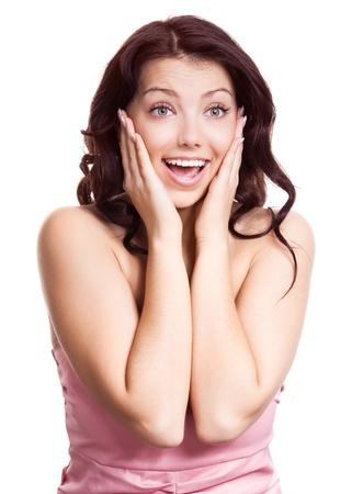cara sorprendida: retrato de una mujer joven sorprendido, aislado contra el fondo blanco Foto de archivo