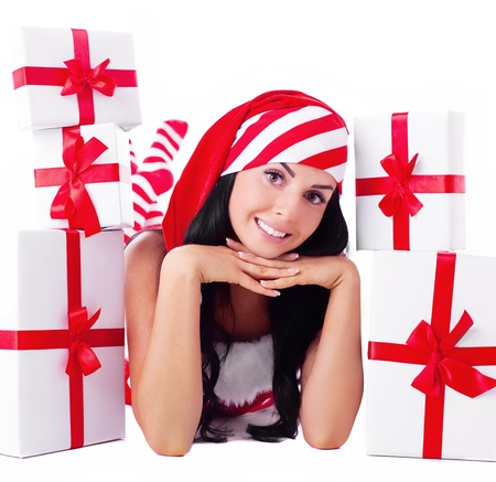 beautiful young brunette woman dressed as Santa with presents, isolated against white background photo