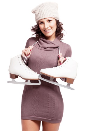 iceskating: beautiful happy young woman going ice-skating, isolated against white background Stock Photo