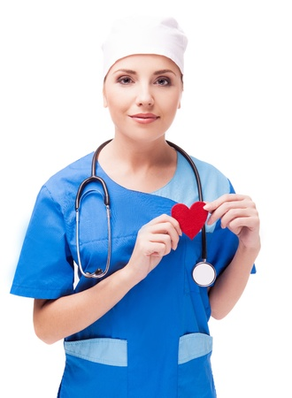 cardiologist with a red heart in her hands, isolated on white background photo