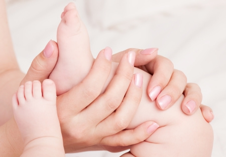 hands of amother massaging her baby