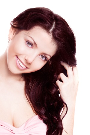 portrait of a young beautiful brunette woman with long curly hair, isolated against white background photo