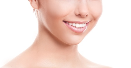 closeup of the healthy white teeth of a woman, isolated against white background, copyspace for your text to the right photo