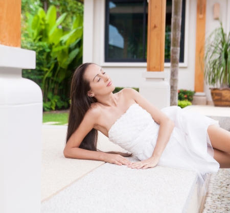 beautiful young brunette woman relaxing in the yard Stock Photo - 16987625